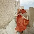 A Model Wearing A Orange Dress by Henry Clarke
