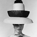 A Model Wearing A Sun Hat by Karen Radkai