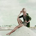 A Model Wearing A Swimsuit And Jacket by Leombruno-Bodi
