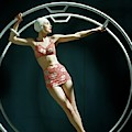 A Model Wearing A Swimsuit In An Exercise Ring by John Rawlings