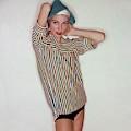 A Model Wearing Swimwear And A Striped Shirt