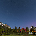 A Moonlit Nightscape Taken In Banff by Alan Dyer
