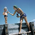 A Mother And Son On A Pier by Toni Frissell