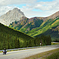 A Motorcyclist Enjoys An Open Stretch by Todd Korol