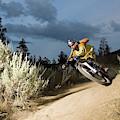 A Mountain Biker Rides A Trail by Blake Jorgenson