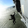 A Naval Air Crewman Jumps From An by Stocktrek Images