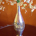 A Painting Silver Vase On Table by Mike Nellums