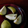 A Plate Of Pears by Romulo Yanes