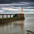 A Red And White Striped Lighthouse by John Short