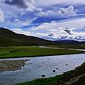 A River Splits The Landscape by Jorgen Strom Roset