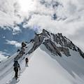 A Rope Team Climbs A Ridge by Alasdair Turner