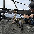 A Sailor Fires An M-240b Machine Gun by Stocktrek Images