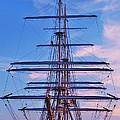 A Tall Ship At Sundown In Baltimore by Marcus Dagan