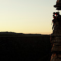 A Silhouette Of A Couple Rock Climbers by Trevor Clark