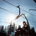 A Skier And Snowboarder Share The Chair by Ryan Heffernan