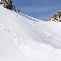 A Small Slab Avalanche With Two Guides by Jeff Curtes