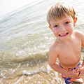 A Smiling Young Boy Enjoys A Sunny by Ty Milford