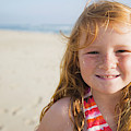 A Smiling Young Girl Enjoys A Sunny by Ty Milford