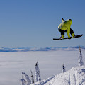 A Snowboarder Catches Air Off A Jump by Noah Couser
