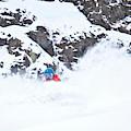 A Snowboarder Riding Through Powder by Rob Hammer
