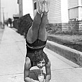 California Girl Imbibes Soda Upside Down by Underwood Archives