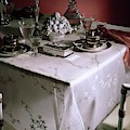 A Table Set With Delicate Tableware by Horst P. Horst