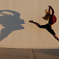 A Teenage Girl Playing With Her Shadow by Woods Wheatcroft