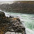 A Tourist Takes A Photo At Gullfoss by Marc Pagani