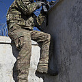 A U.s. Soldier Provides Security At An by Stocktrek Images
