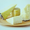 A Variety Of Cheese On A Plate by Romulo Yanes