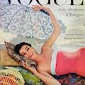 A Vogue Cover Of Anne Gunning Under An Umbrella by Karen Radkai