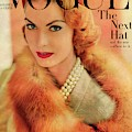 A Vogue Cover Of Mary Mclaughlin Wearing A Fox by Horst P. Horst