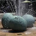 A Water Fountain With Dinosaur Eggs In The Universal Studios Singapore by Ashish Agarwal