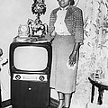 A Woman And Her Tv by Underwood Archives