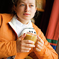 A Woman Enjoys A Warm Cup Of Cocoa by Ty Milford