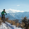 A Woman Fat Biking On The Trails by Mike Schirf