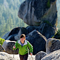 A Woman Hiking High In The Mountains by Corey Rich