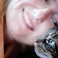 A Woman Lovingly Looking At Her Cat by Ron Koeberer