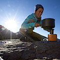 A Woman Making Coffee With Portable by Woods Wheatcroft