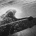 A Woman On A Surfboard Under The Water by Ben Welsh