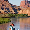 A Woman Reading At A Camp Along Utahs by Chris Noble