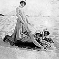 A Woman Rides On Two Friends by Underwood Archives