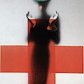 A Woman Standing Behind A Red Cross On Frosted by Erwin Blumenfeld