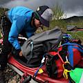 A Woman Unloads Her Kayak by Krystle Wright