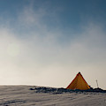 A Yellow Pyramid Tent In The Snow, Mt by Dan Shugar