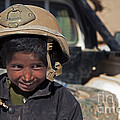 A Young Boy Wears A Coalition Force by Stocktrek Images