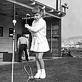 A Young Girl Hits A Golf Ball by Underwood Archives