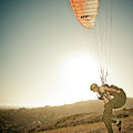 A Young Man Launches His Paraglider by Kevin Steele
