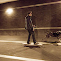 A Young Man On A Skateboard Is Pulled by Andrew Kornylak