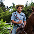 A Young Man Sits On A Horse And Smiles by Modoc Stories